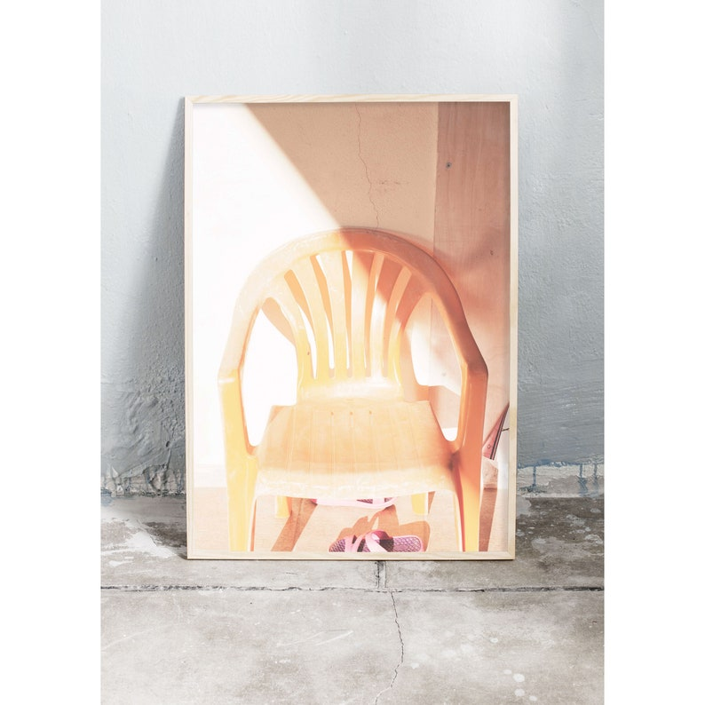 Photography art print of a yellow garden chair in the image 0