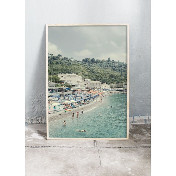 Photography art print of the beach, green ocean and mountains in Sorrento, Italy. Print is printed on a high quality, matte paper.