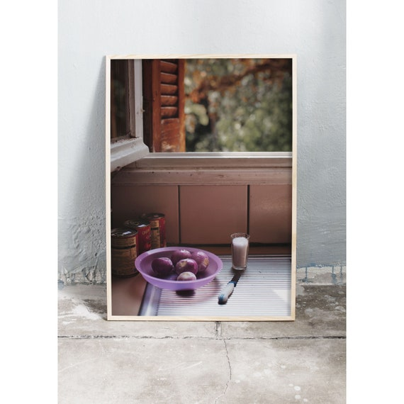 Photography art print of photo from a kitchen in Greece with red onions and an open window. Printed on a high quality, matte paper.