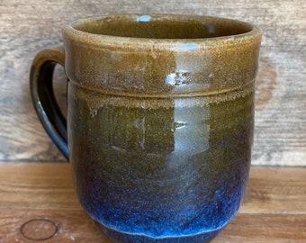 Raw sienna and floating blue glazed mug.