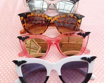 582f840877 Creepy black bat sunglasses in black and white halves pink tortoise shell  or grey