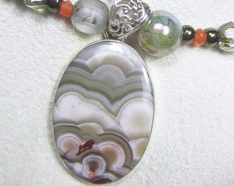 Silver Linings - OOAK sterling necklace with Laguna Lace agate, carnelian, glass beads, clouds, storm, sunlight,