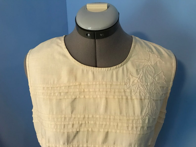 Ivory Pleated Silk Look Blouse with Floral Appliqu\u00e9
