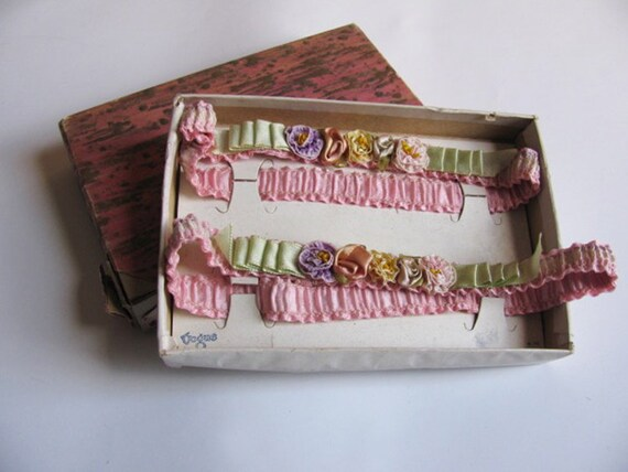 Vogue pair of ribbon work garters