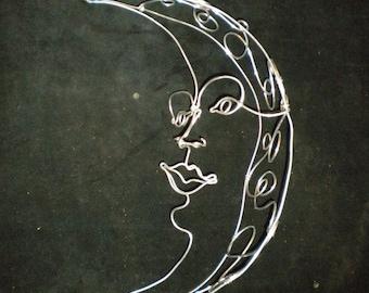 Moon w/ face--3-D  wire sculpture
