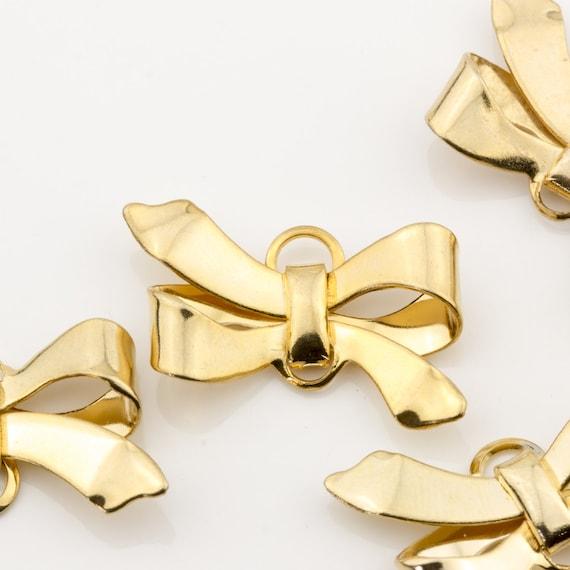 Vintage gold ribbon-shaped earrings