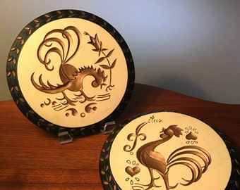Mid century black and gold rooster chalkware wall plaques