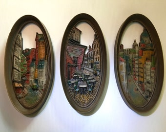 A trio of retro cityscape scenes resin wall plaques by Burwood Products - 4382, 4383, 4384