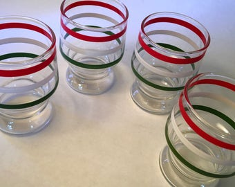 Set of four juice glasses with red, white and green bands