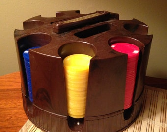 Retro poker chip caddy with various colored poker chips