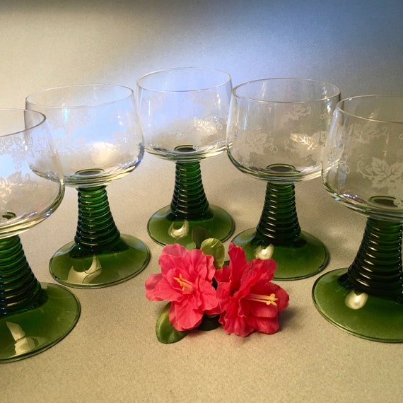 set of five wine goblets with green coil stems and etched grapes with leaves