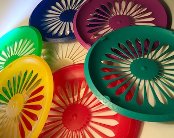 Set of seven vintage plastic paper plate holders from the 90s