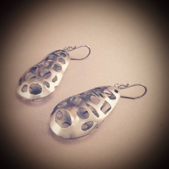 Hollow, pierced sterling silver earrings