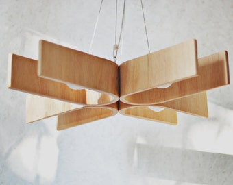 hanging lamp made from bent plywood. The Eyes