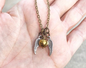 golden snitch necklace etsy