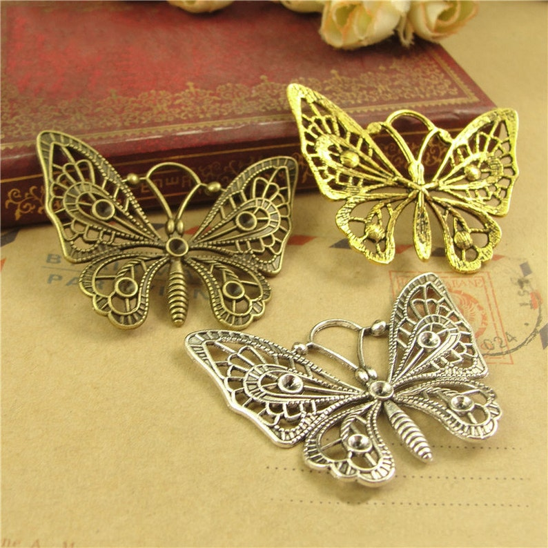 10 Silver Alloy Butterfly Charms for Crafts Cards Favours Bracelets 03