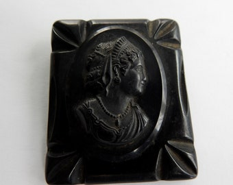 Celluloid Cameo on Carved Bakelite Brooch