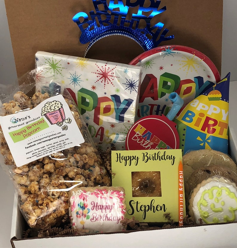 care package filled with happy birthday popcorn, party hat, party decor, and home baked goodies