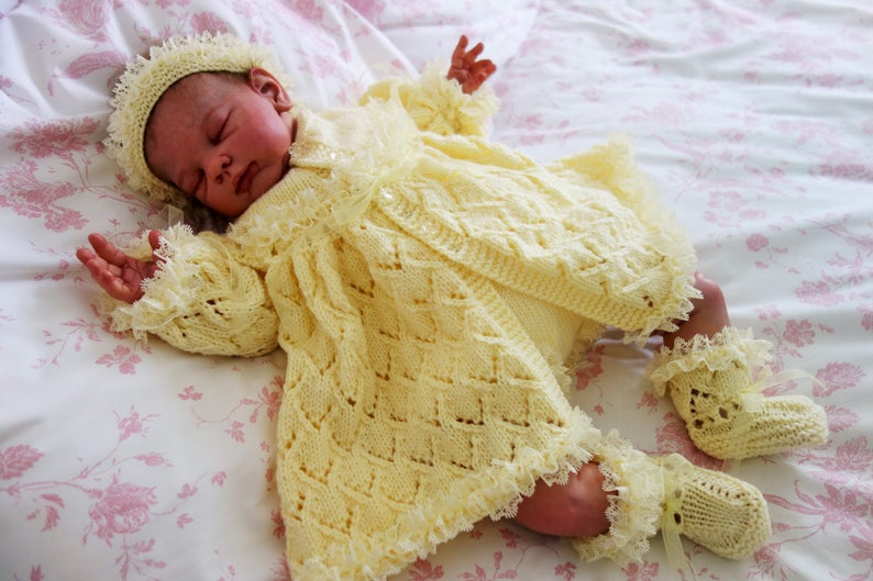eb146c479 Hand knitted fancy baby girl s outfit comprising matinee