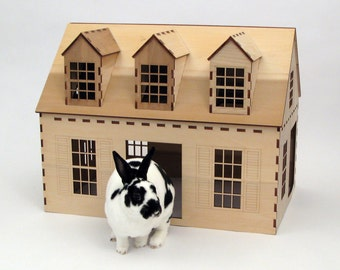 Cape Cod style wooden playhouse for rabbits, chinchillas, and small animals