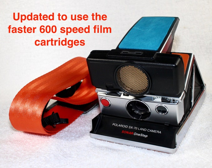 Rebuilt SX70 Sonar with fun orange and blue skins - updated for 600 film and with new wide neck strap