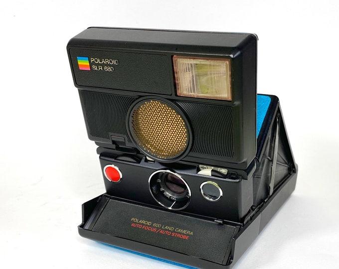 Rebuilt Blue skinned Polaroid SLR 680 Camera