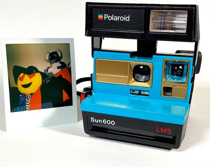 Polaroid Sun 600 with Upcycled turquoise and gold face - Refreshed, Cleaned and Tested