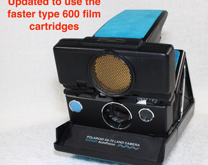 Rebuilt Polaroid SX70 Sonar Autofocus special black body - Updated to use 600 Film Cartridges and New Turquoise Skins