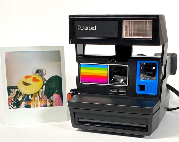 Polaroid Sun 600 with Upcycled blue and rainbow face - Refreshed, Cleaned and Tested