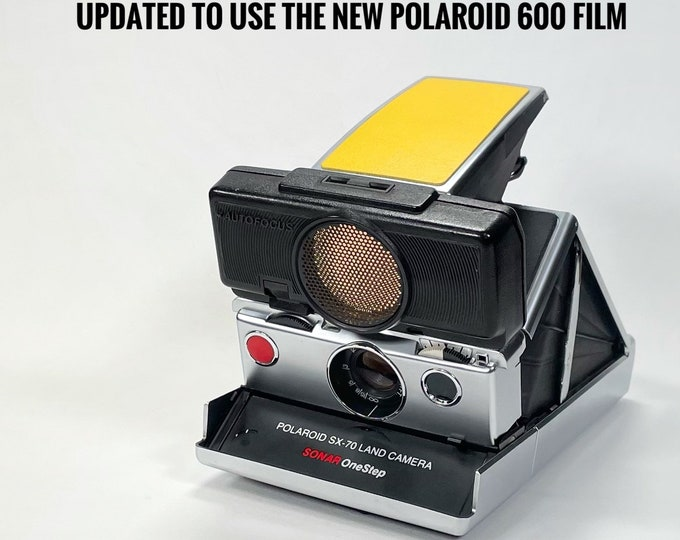 Rebuilt Polaroid SX70 Sonar Autofocus  - Updated to use 600 Film Cartridges and New Black and Yellow Skins