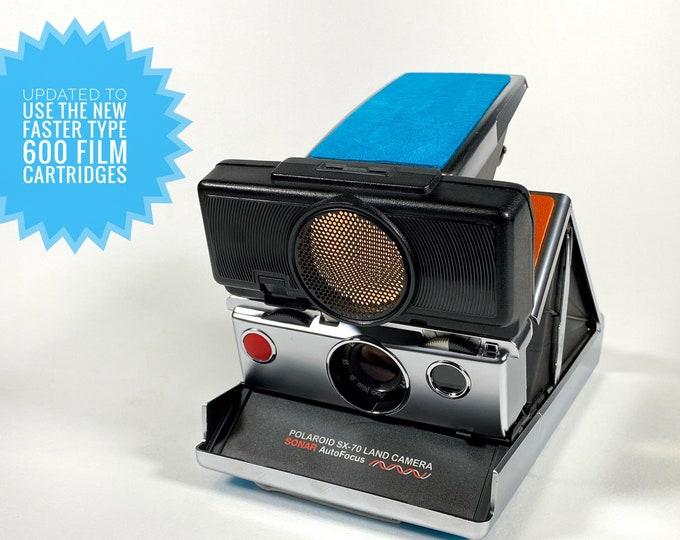 Rebuilt Polaroid SX70 Sonar Autofocus - Updated to use 600 Film Cartridges and With New Orange & Blue Skins