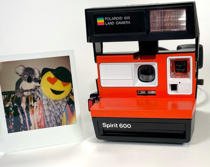 Polaroid Spirit 600 with Upcycled orange and white face - Refreshed, Cleaned and Tested