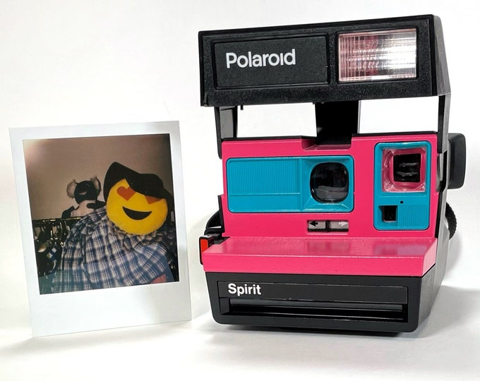 Polaroid Sun 600 with Upcycled pink and turquoise face - Refreshed, Cleaned and Tested