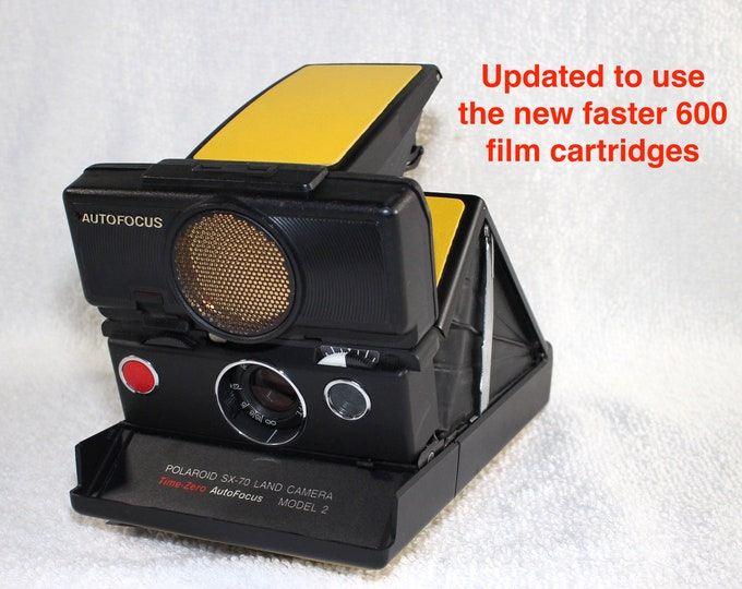 Rebuilt Polaroid SX70 Sonar Autofocus special black body - Updated to use 600 Film Cartridges and New Yellow Skins