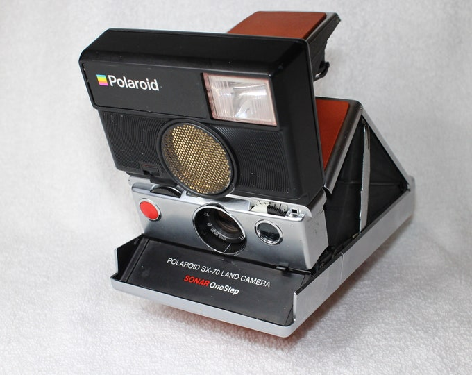 Rebuilt Polaroid SLR 680 Camera with unique silver body and new tan skins