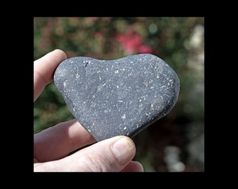 Heart shaped rock, heart rock stone found on the beach surf tumbled