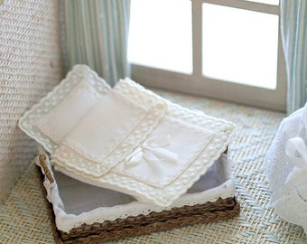 Miniature bedding for crib or baby stroller.  1:12 scale. The highest quality of embroidery, sewing and lingerie made entirely by hand .