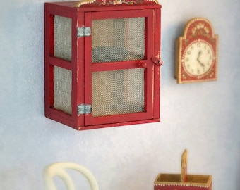 Kitchen cabinet with metal mesh on the door and sides. scale 1:12. The accesories aren't inclued in the price. Making handmade.