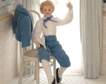 Child sitting in blue clothing, porcelain, articulated 1:12 scale (dollhouse).OOAK