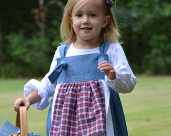 Belle in her country dress with double apron and blue classic cotton and tie knots