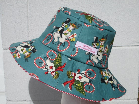 520b2f2e42a Bucket Hat 23 Large Christmas Snowmen on bicycles with