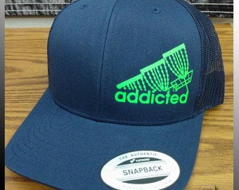 aabec2a3cd1 Snap Back - Disc Golf Addicted - FlexFit   Yupoong Brand Snap Back  Cotton Polyester Trucker Hat - Anhyzer Designs Original