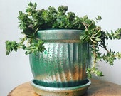 green and mercury glass like upcycled repurposed boho planter with attached drainage plate