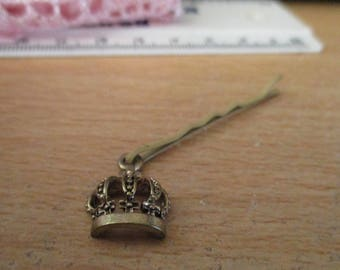 """vintage silvertone charm in marcasite effect it is a crown with a cross on top approx 1/2""""high painted clip is 1.75""""long"""