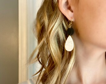 Black and white spotted star dangle earrings  statement jewellery  clay earrings