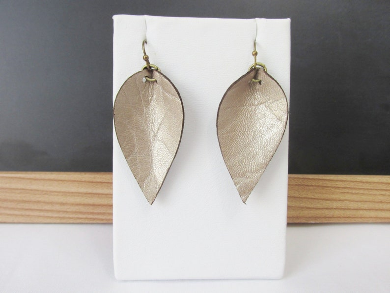 Small Champagne Gold Leather Leaf Earrings Joanna Gaines Inspired  Soft Gold Leather Earrings Leather Petal Earrings  Boho Earrings