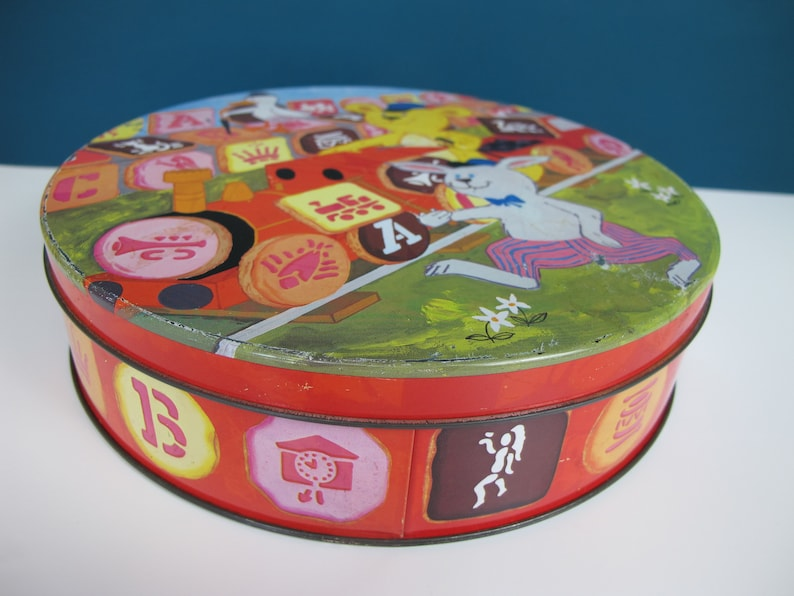 1970s-80s Vintage Peek Freans Playbox round tin Lovely illustrations Originally contained iced Playbox biscuits