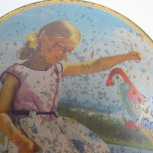 Vintage round tin Made in England. Small round toffee tin girl with parrot Edward Sharp and Sons Ltd