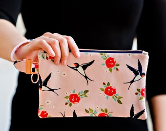 Old-school tattoo-inspired swallows and roses pink carry-all clutch with rose gold hardware
