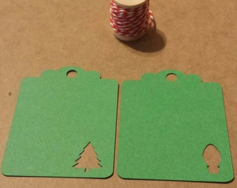 24 Christmas tags/Holiday tags and baker's twine.  2.5'x2'. Hand punched.